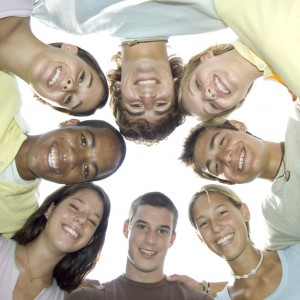 Teenagers Smiling in Group Hug